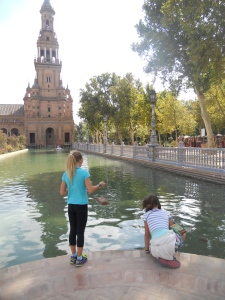 Savannah and Sky checking out the fish in the canal around Plaza de Espana