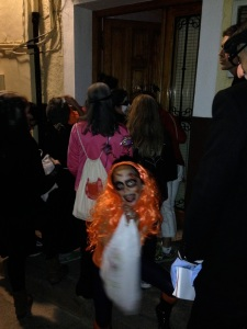 Spooky me in the crowd of hooligans! Candy, Chestnuts, Ham galore, TRICK OR TREATING for door to door.