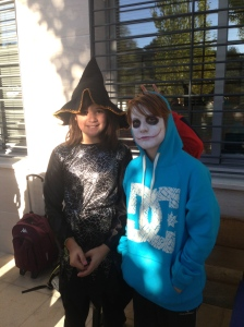 Eva and Ricardo dressed in their costumes for school. Eva dressed as a spider witch and Ricardo dressed as the joker. :)
