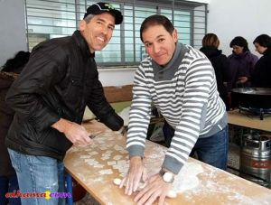 Mike and Juan Jo cutting dough