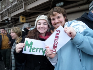 Laura and Max, Americans traveling in Paris.   They let us borrow their sign!