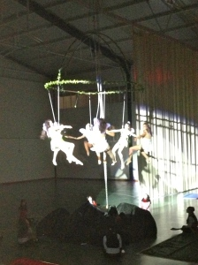 Not the best picture. This is the older gymnasts doing ariel tricks suspended from a ring in the middle of the gym