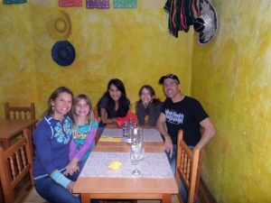Leslie, Savvy, Carolina, Sky and Mike waiting for our burritos. Does the wall look familiar to anyone! Love it!