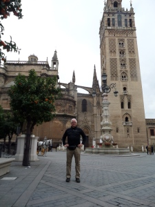 Here is my dad, on our trip to Sevilla with the famous, Christian-ified minaret behind him