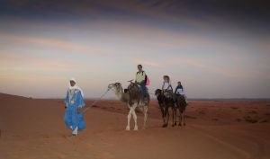Cathy, Jessica and Catherine's camel ride looks more authentic than ours!